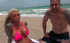 Dirty blonde MILF tanning at the beach gets all oiled up