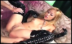 Sex in shiny black thigh high boots and gloves